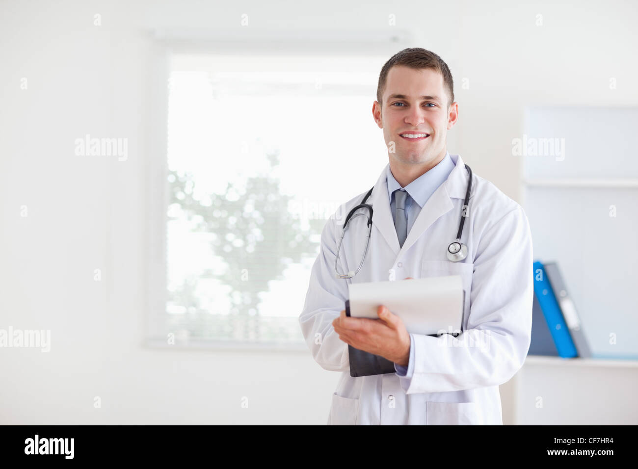 Doctor having good news for his patient - Stock Image