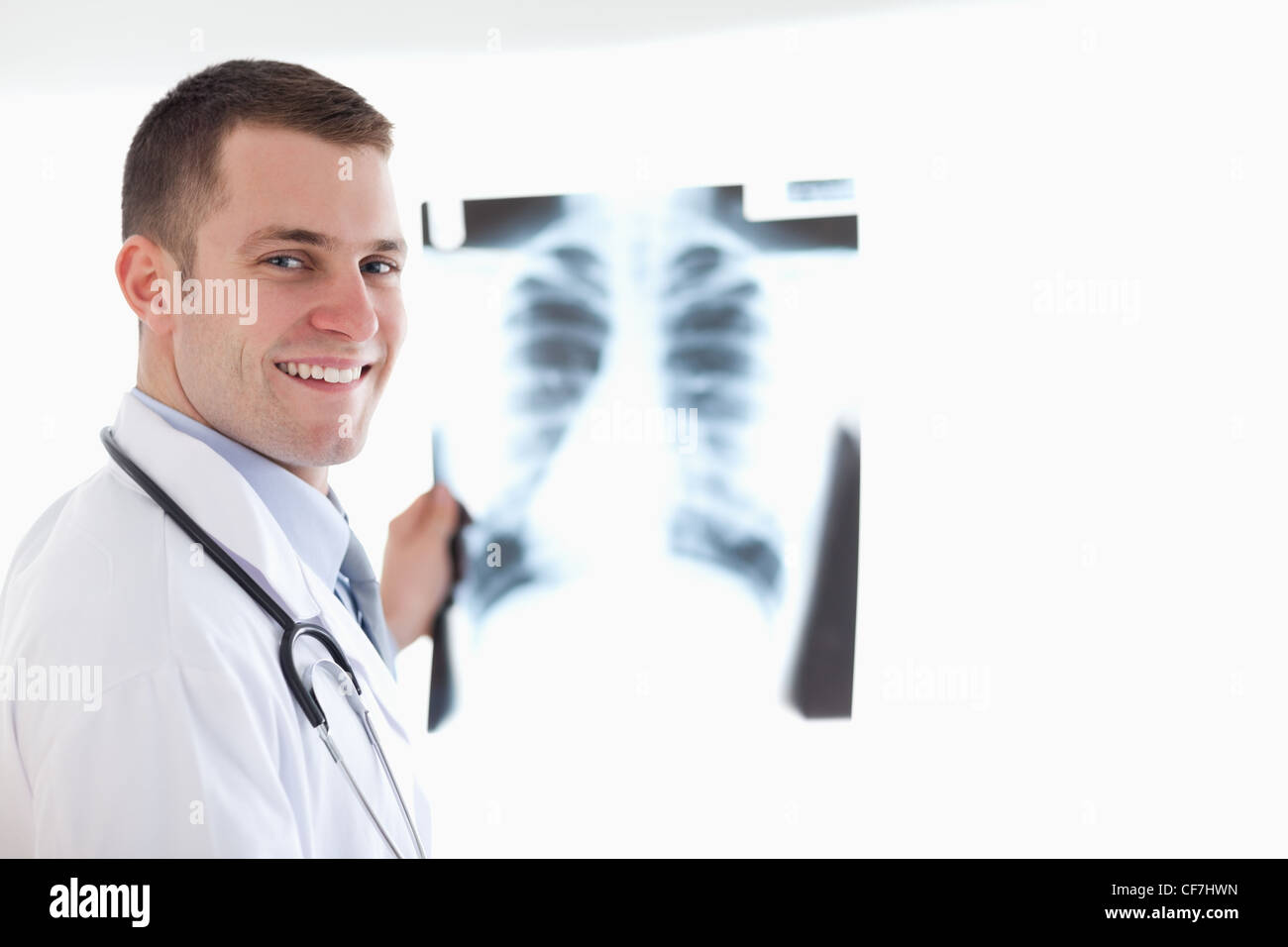 Smiling doctor with x-ray - Stock Image