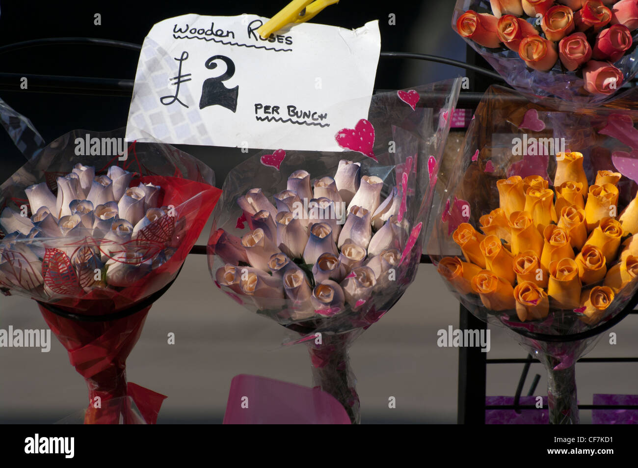 Florists Display Of Bunches Of Wooden Imitation Roses Flowers - Stock Image