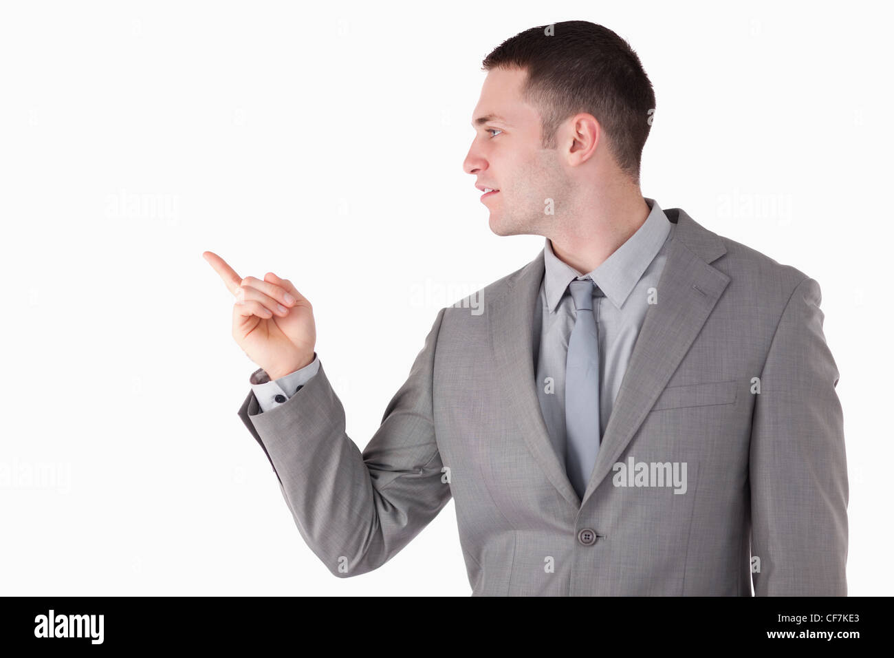 Businessman pointing at something - Stock Image