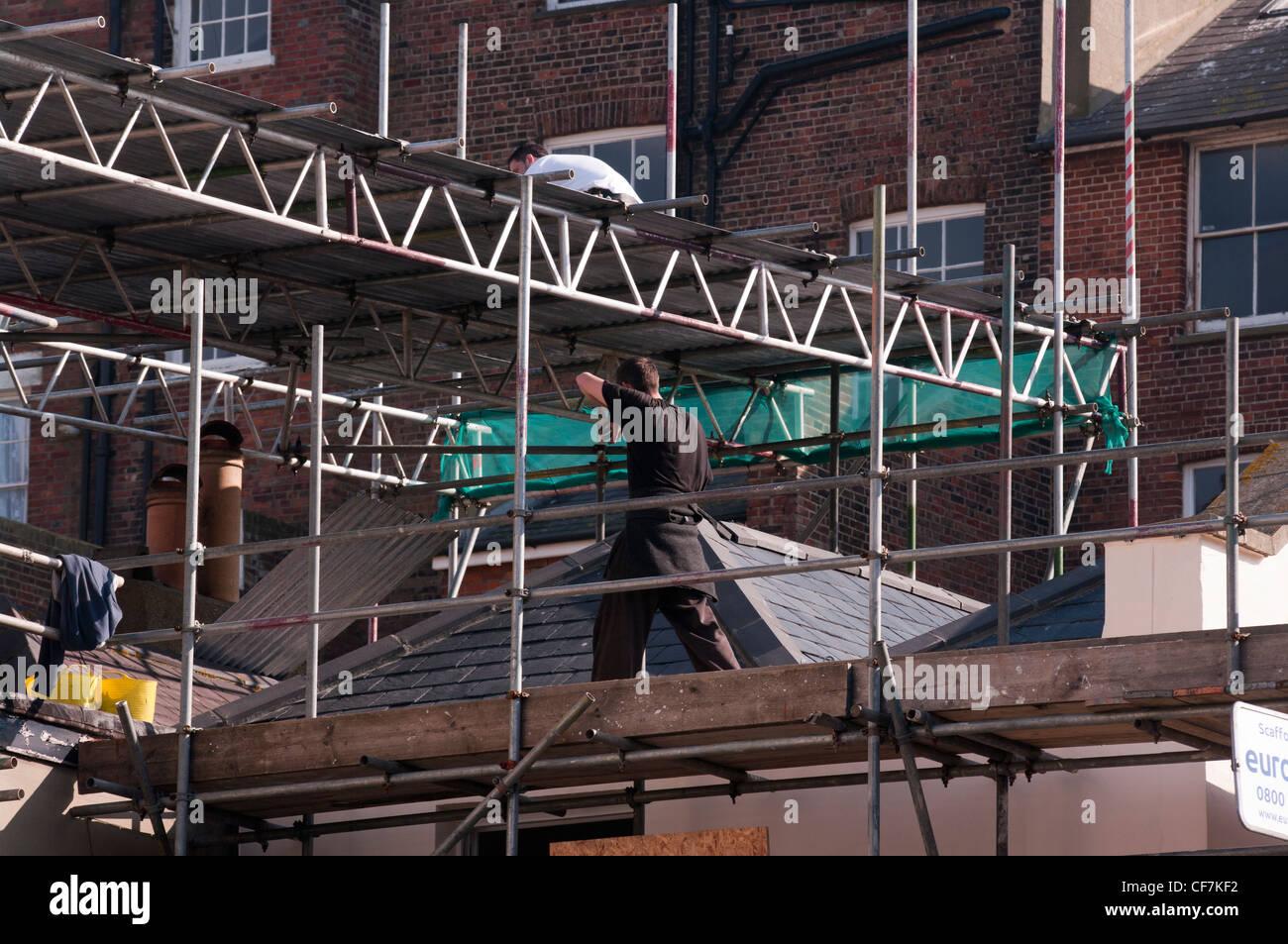 Workmen Builders Scaffolders Working On Scaffolding - Stock Image