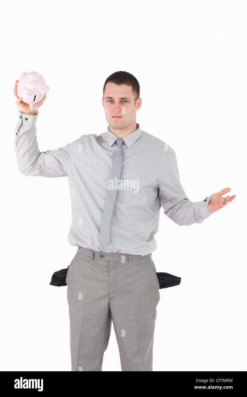 Portrait of a broke businessman with empty pockets - Stock Image