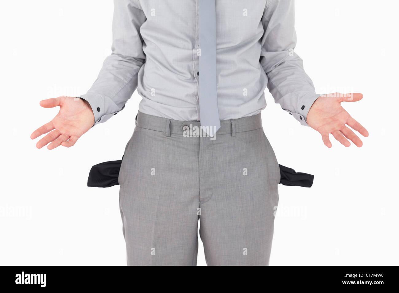 Broke businessman with empty pockets - Stock Image