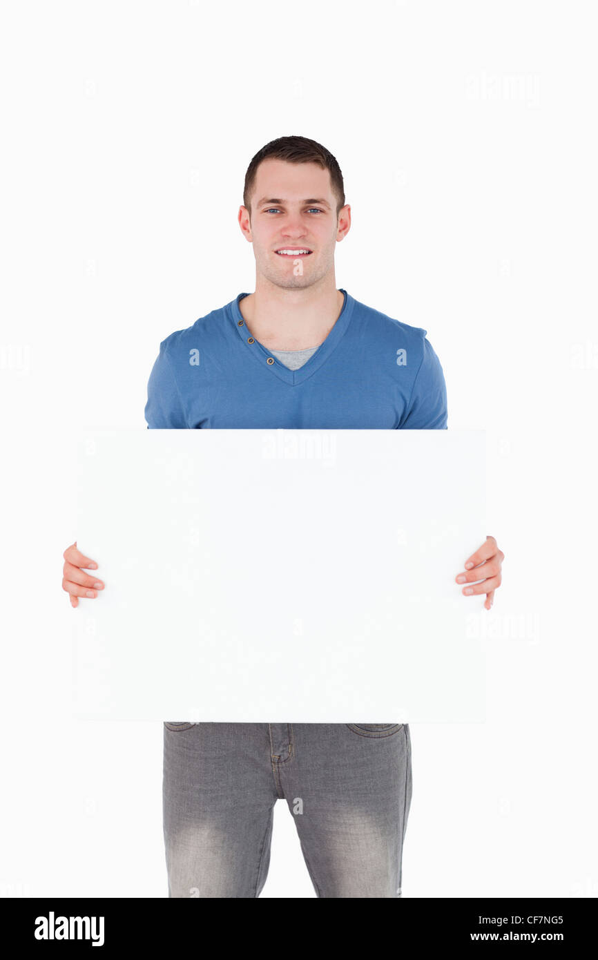 Portrait of a man holding a blank panel - Stock Image