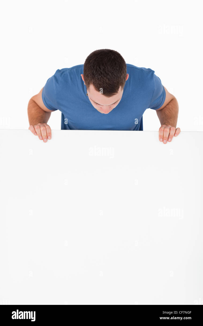 Portrait of a man looking at a blank panel - Stock Image