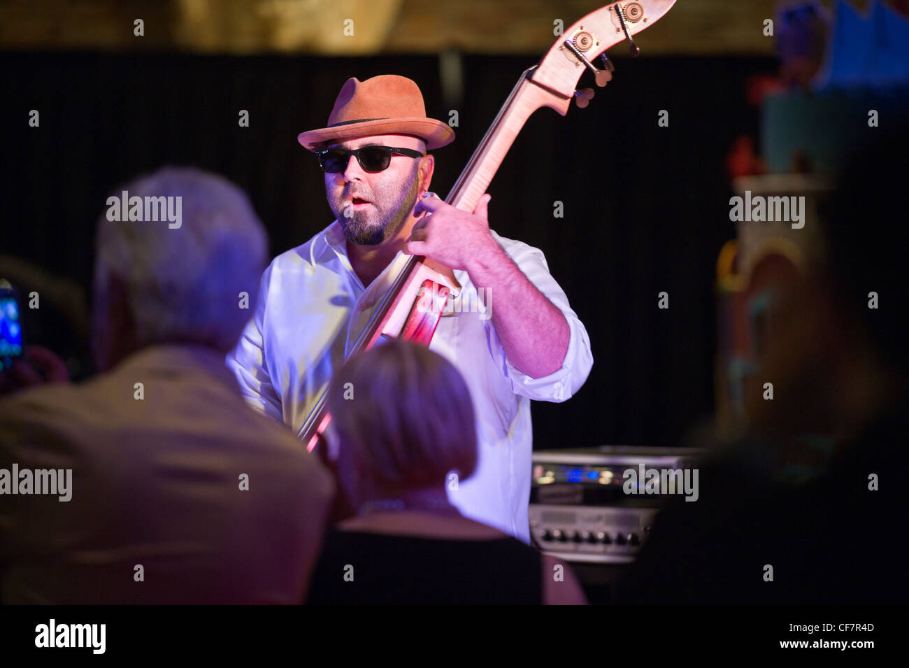 Ace of Cakes Duff Goldman playing string bass performance at AVAM in Baltimore, MD - Stock Image