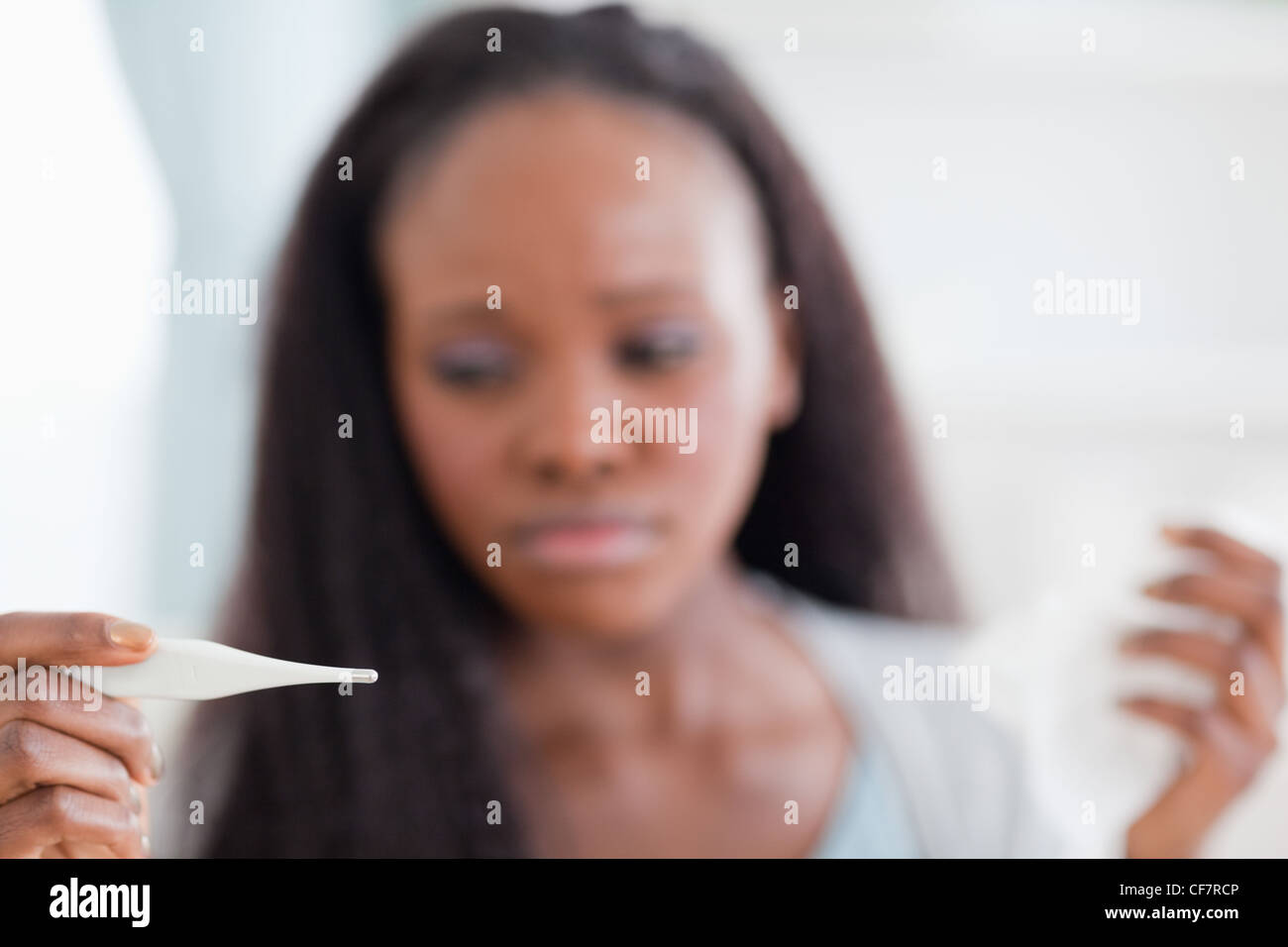 Close up of thermometer being used by woman - Stock Image