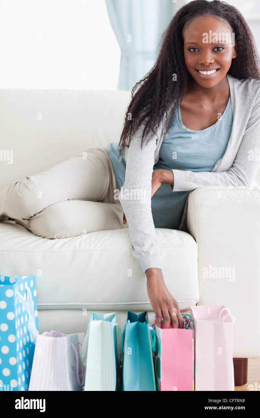 Close up of young woman happy about her shopping - Stock Image