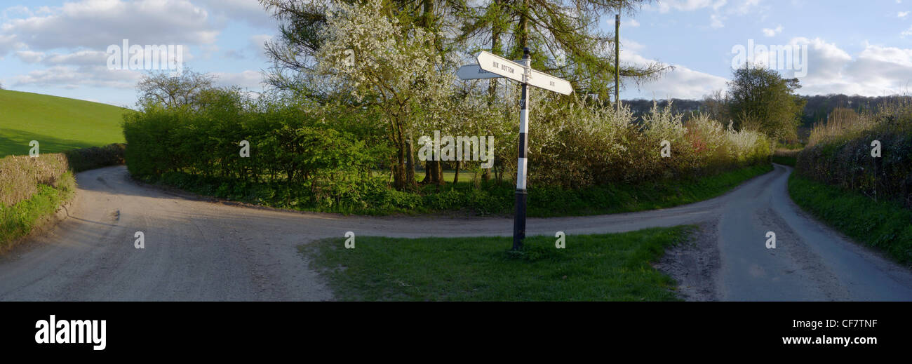 Panoramic panorama of a rural English road junction with signpost - Stock Image