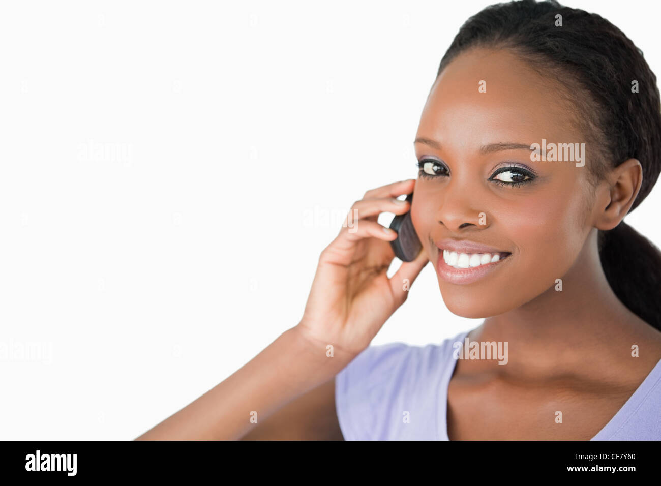 Close up of woman on the phone against a white background Stock Photo