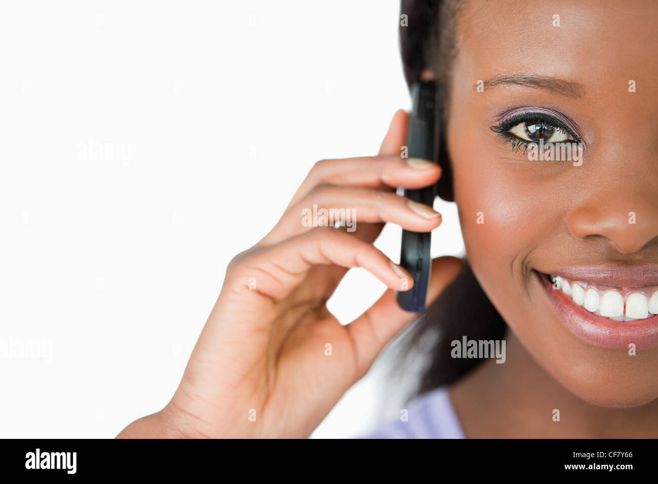 Close up of woman on her phone against a white background Stock Photo