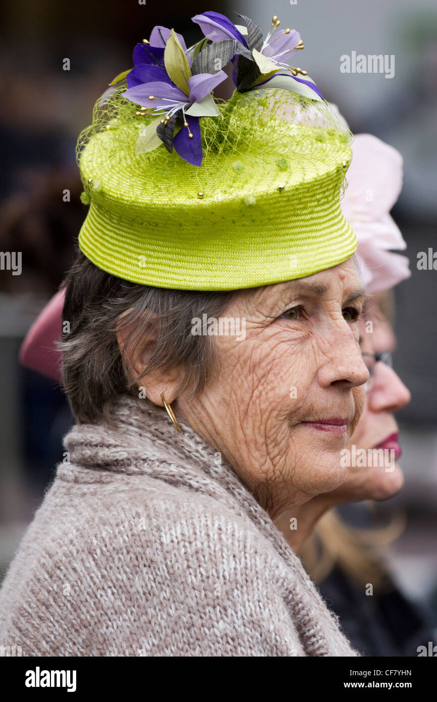 fashionable older woman with fancy hat coming from Melbourne horse races outside Flinders Street Station, Melbourne, - Stock Image