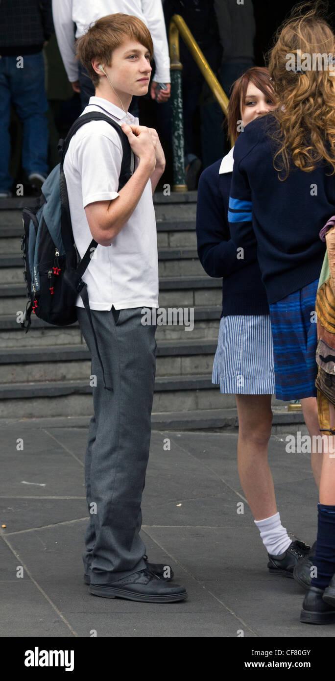 schoolboy and schoolgirls outside Flinders Street Station, Melbourne, Australia - Stock Image