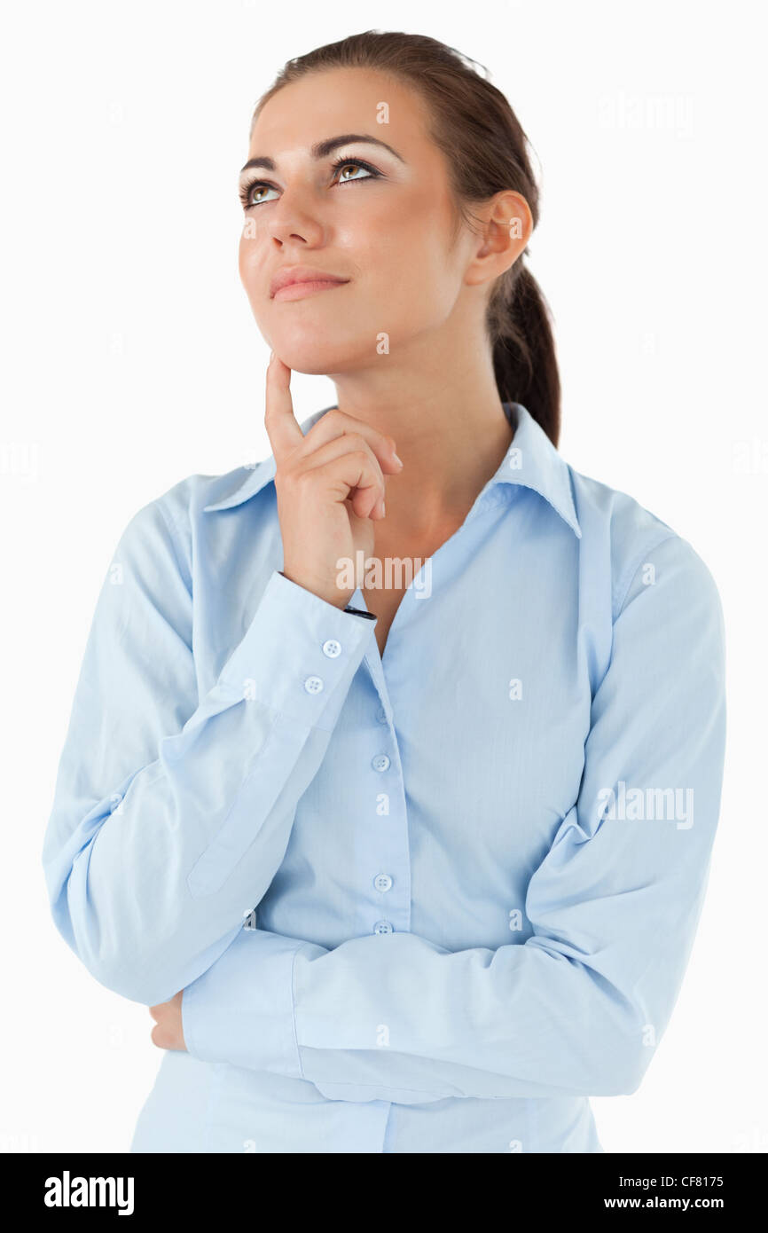 Thinking businesswoman looking diagonally upwards - Stock Image