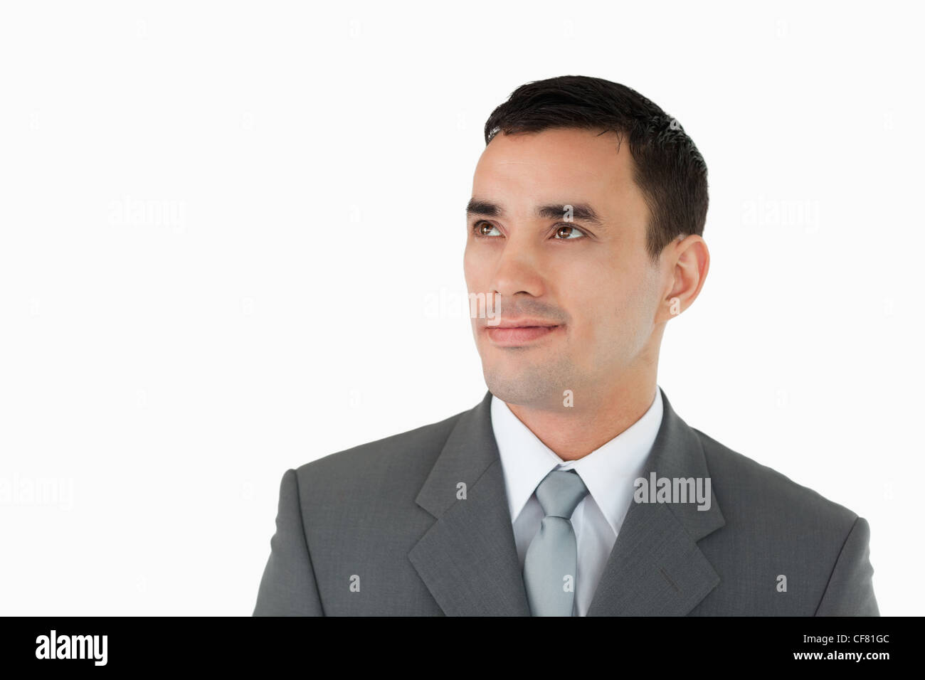 Businessman looking diagonally upwards - Stock Image