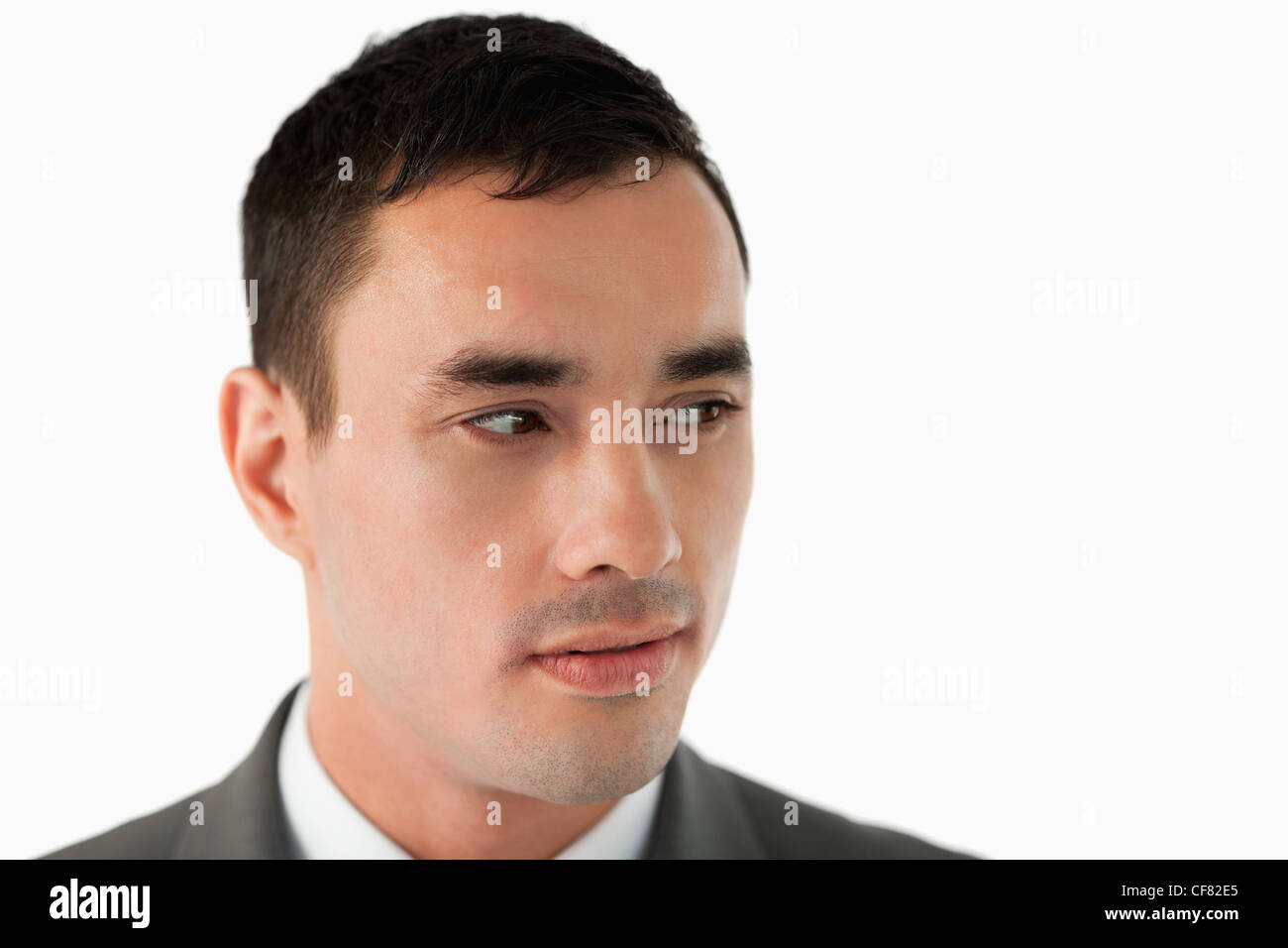 Close up of businessman looking to his left - Stock Image