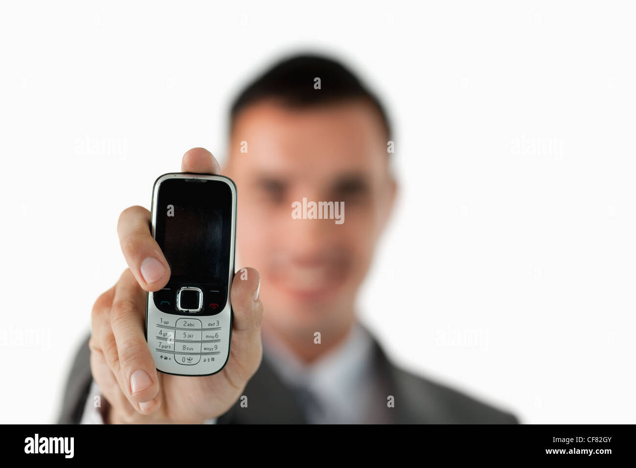 Close up of phone being shown by businessman - Stock Image
