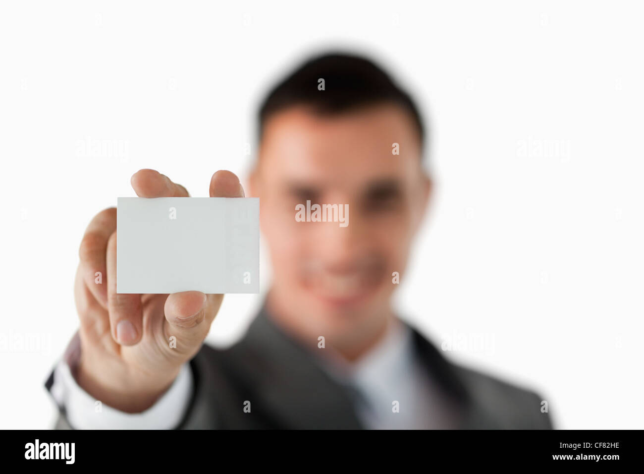 Close up of business card being shown by businessman - Stock Image