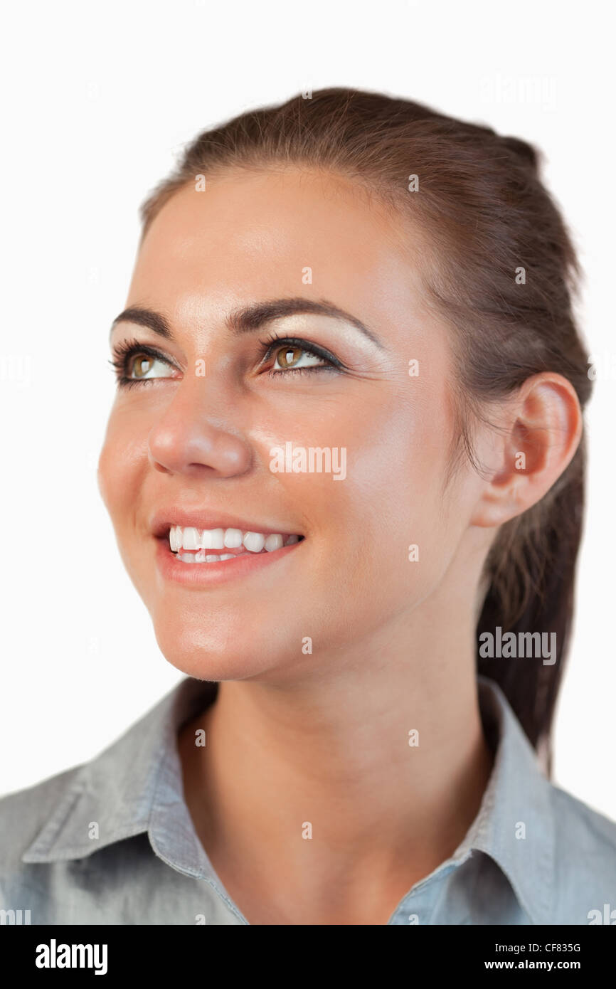Portrait of businesswoman looking diagonally upwards - Stock Image