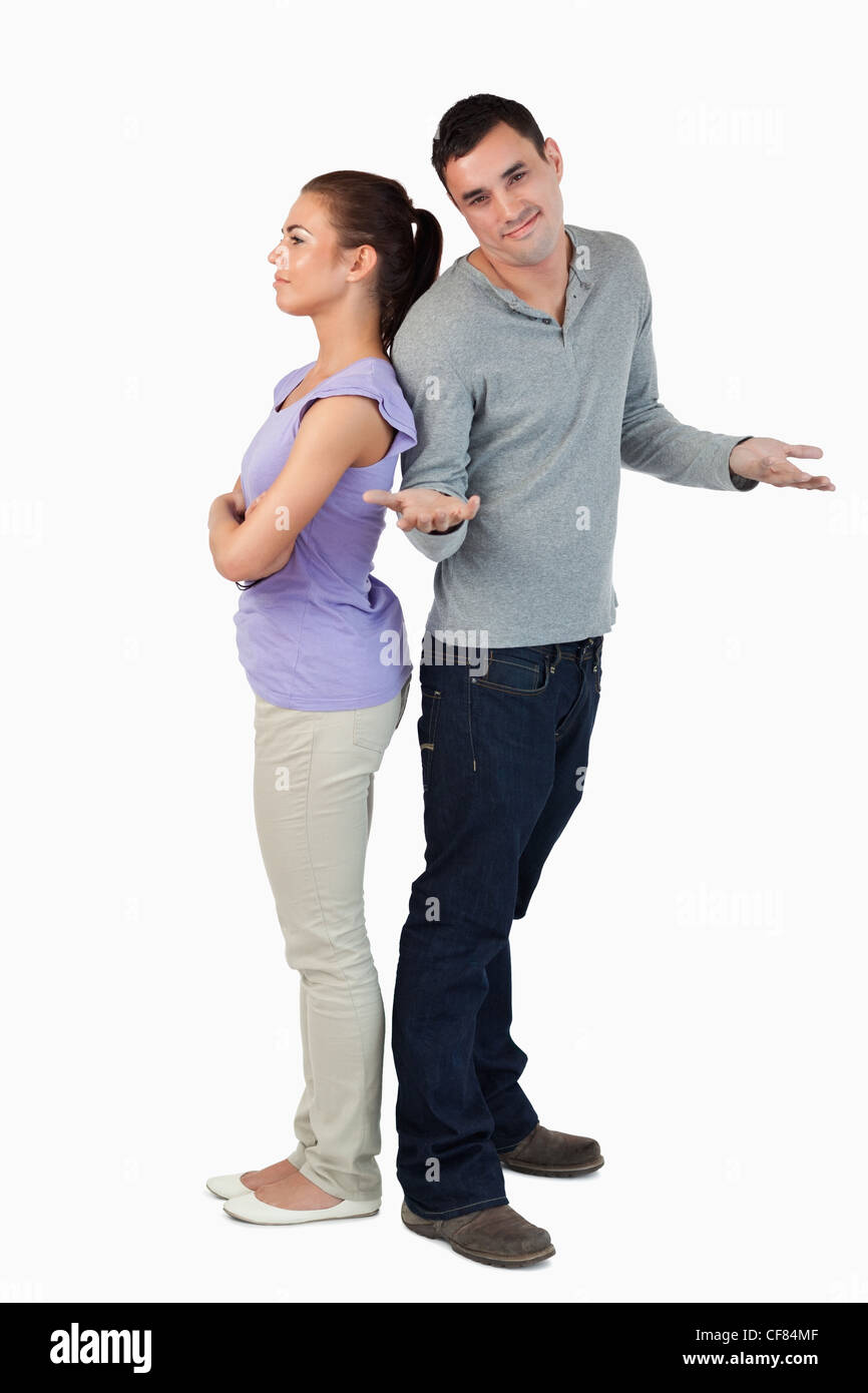 Young male doesn't know what's wrong with his girlfriend - Stock Image