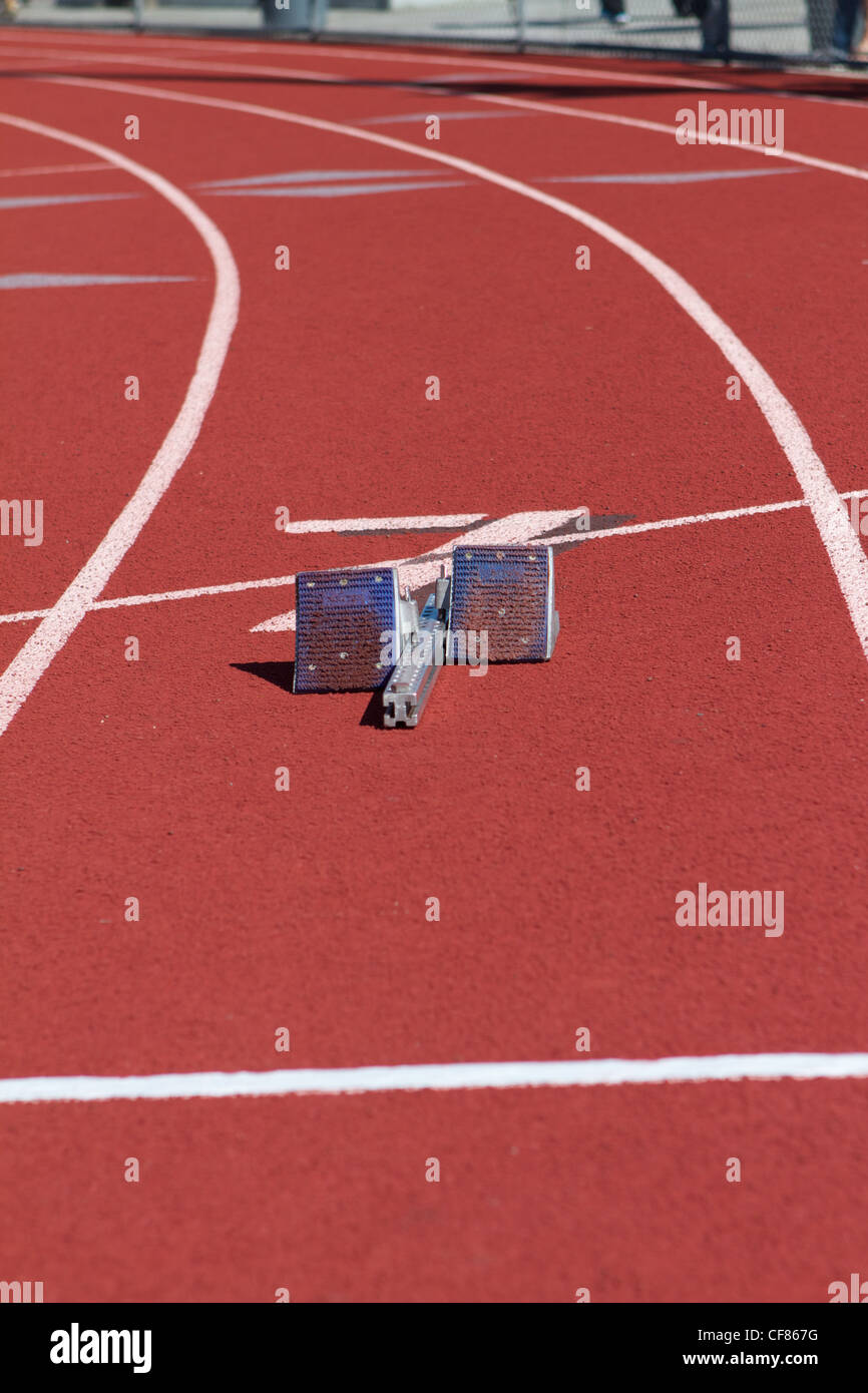 Starting blocks in a lane on a running track - Stock Image