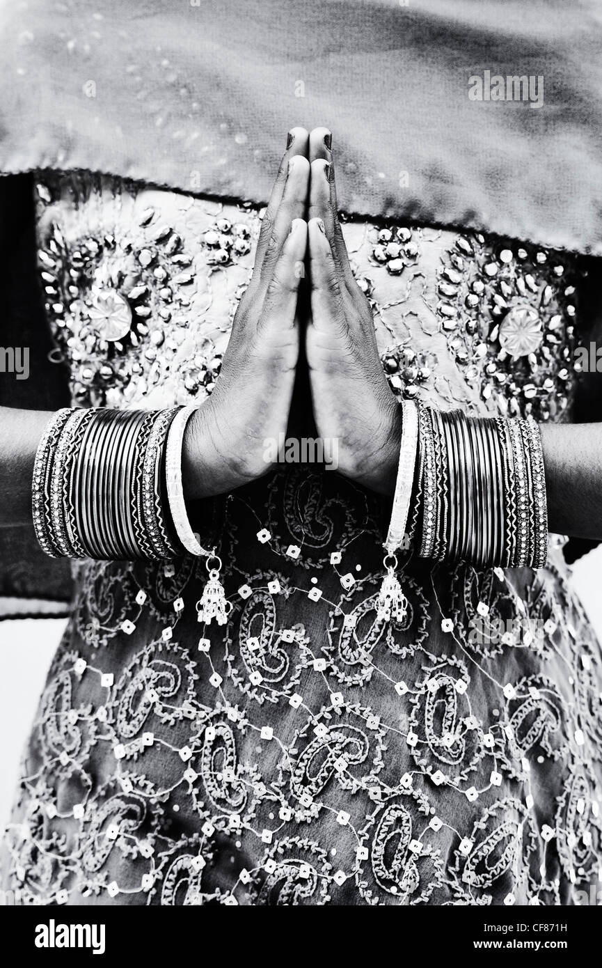 Indian girl namaste prayer hands. Monochrome - Stock Image