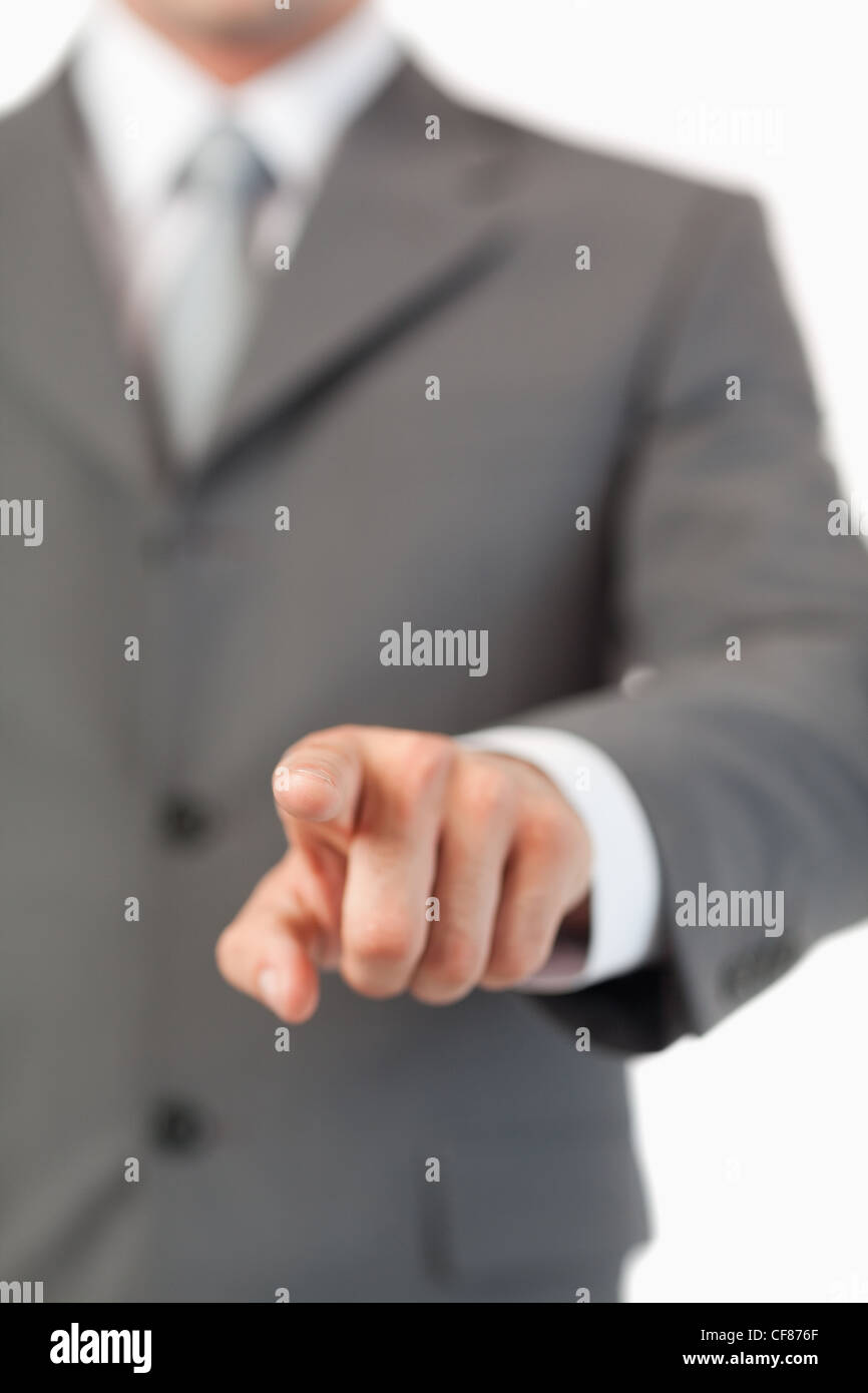 Close up of masculine finger pressing a invisible touchscreen - Stock Image