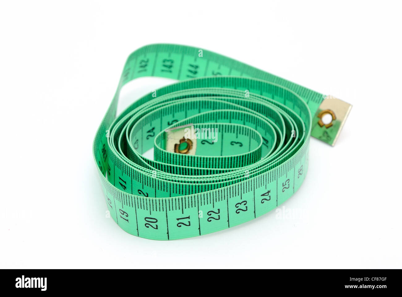 Detail image of twisted green inch tape. - Stock Image