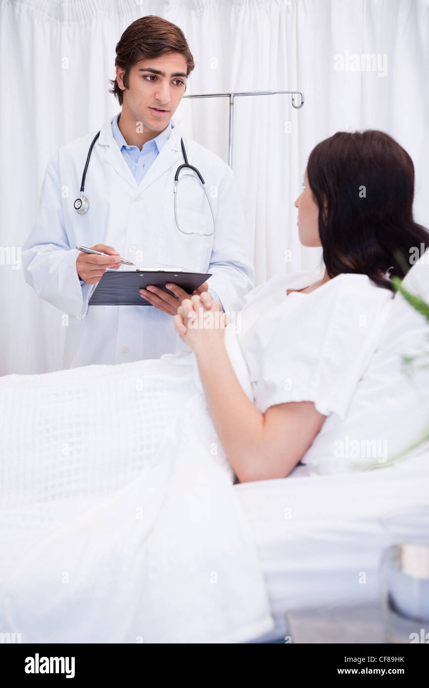Doctor preparing his patient for surgery - Stock Image