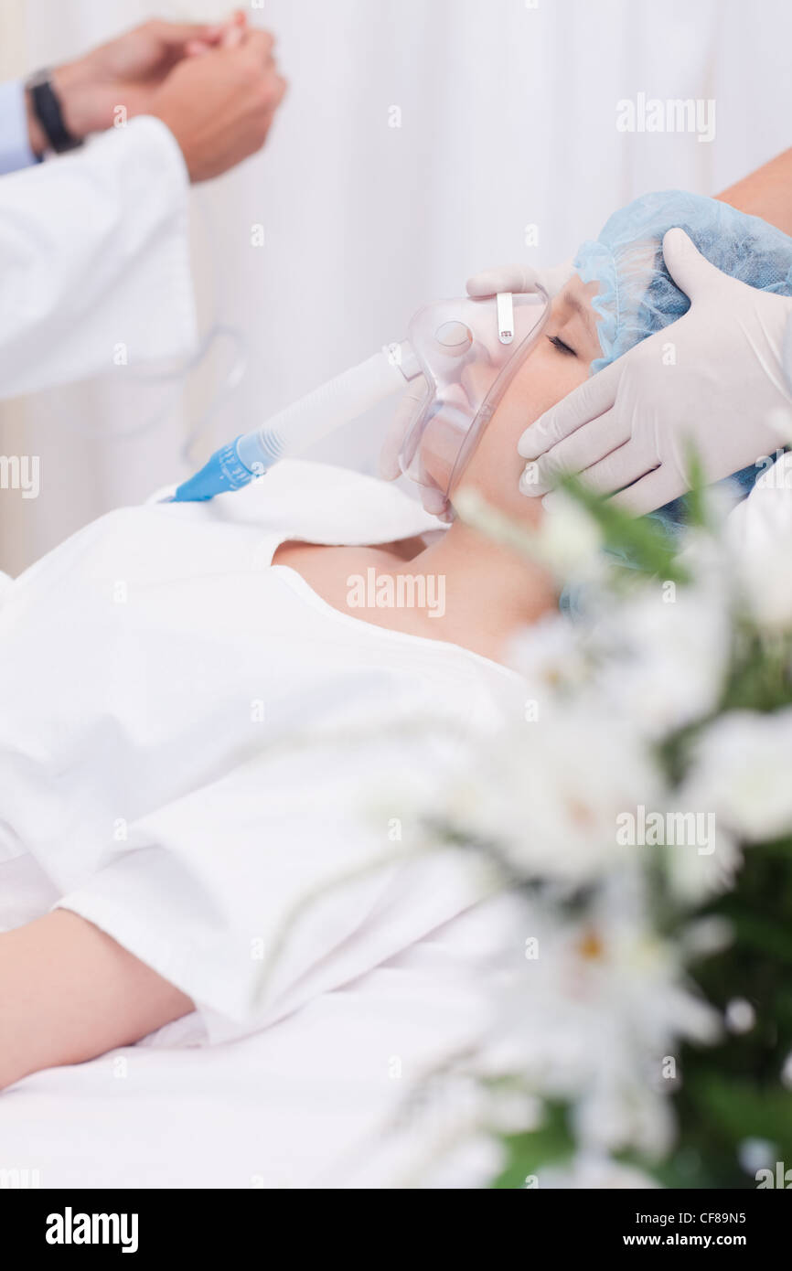 Woman in the intensive care unit - Stock Image