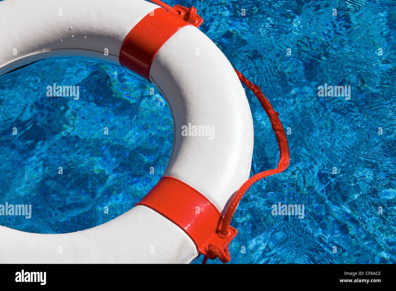 an emergency tire floating in a swimming pool. photo icon for aid, debt and bankruptcy - Stock Image