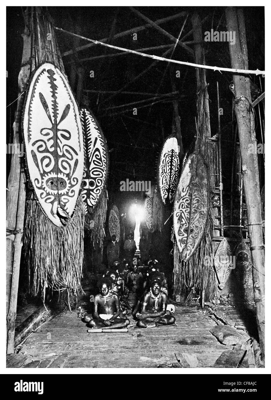 Dubu clubhouse masks shields weapons skull rack 1927 Papua New Guinea - Stock Image