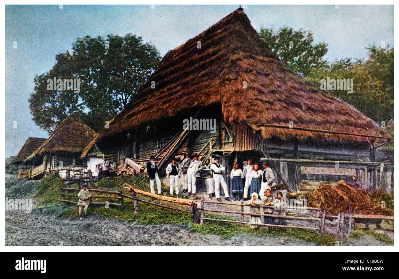 1927 Thatch Peasant home in Volovec Ruthenia Czechoslovakia. - Stock Image