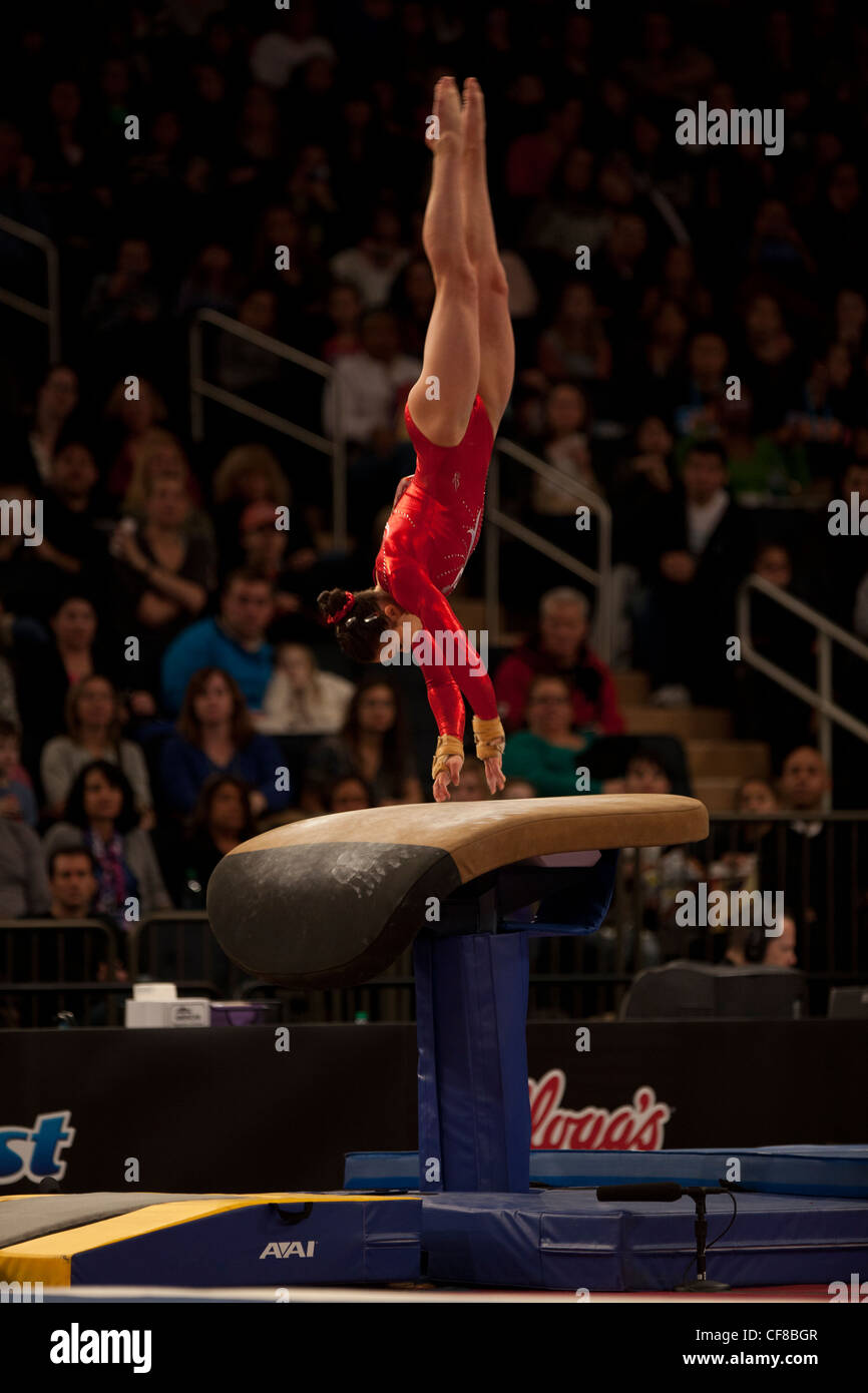 Victoria Moors (CAN) competes in the vault event at the 2012 American Cup Gymnastics - Stock Image