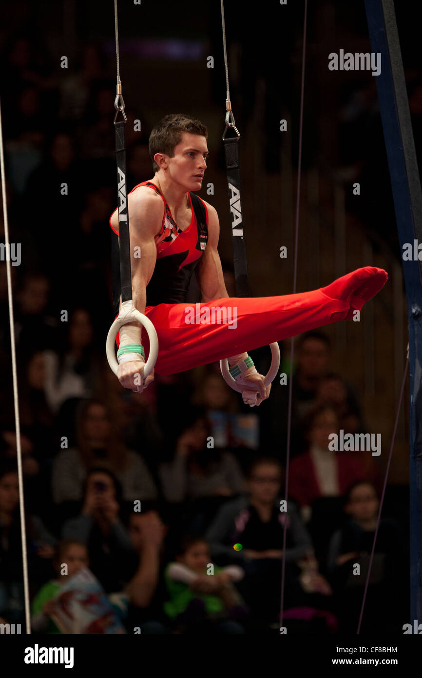 Jackson Payne (CAN) competes in the still rings event at the 2012 American Cup Gymnastics - Stock Image