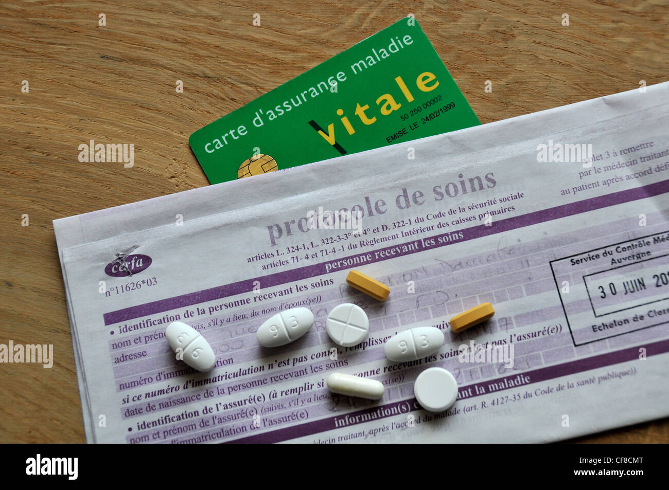 Vitale card sheet treatment protocol of french social security form - Stock Image