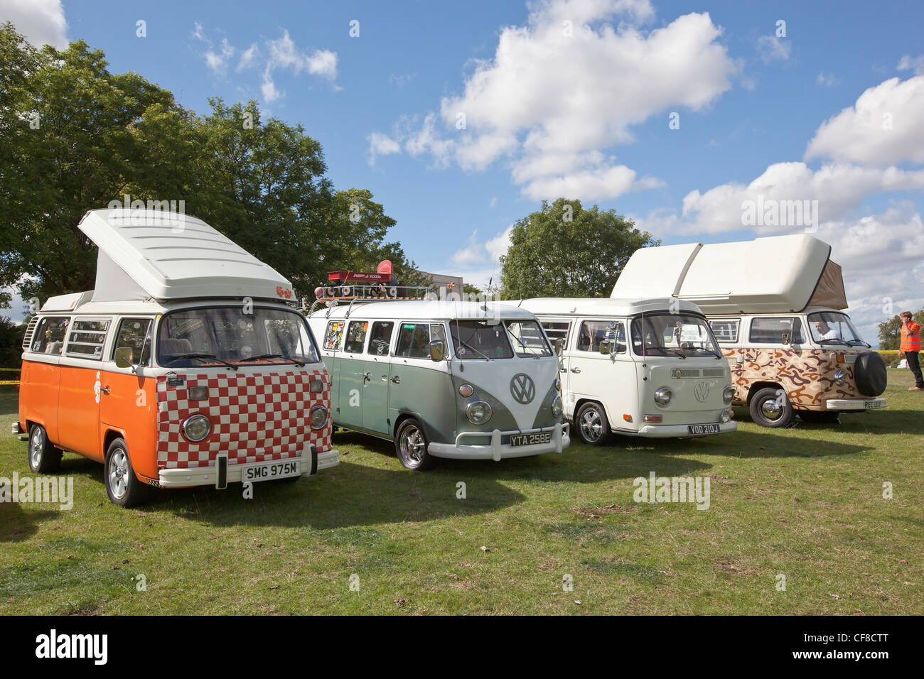 Front view of a row of VW campervans at the Thornfalcon Classic Car Show