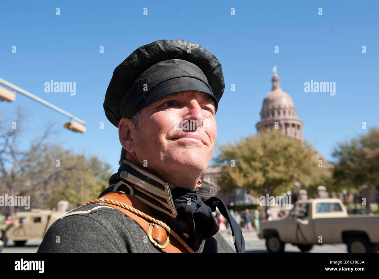 John Tyler of Austin, dressed as a Texas soldier, pauses at the State Capitol as Texas Independence Day on March - Stock Image