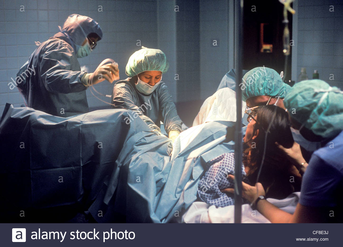 The birth of a baby in a hospital delivery room. - Stock Image