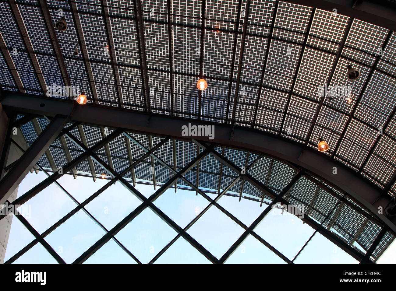 Glass roof of Messe-Essen, fairground. Solar panels are included in the glass tiles to generate solar power energy. - Stock Image
