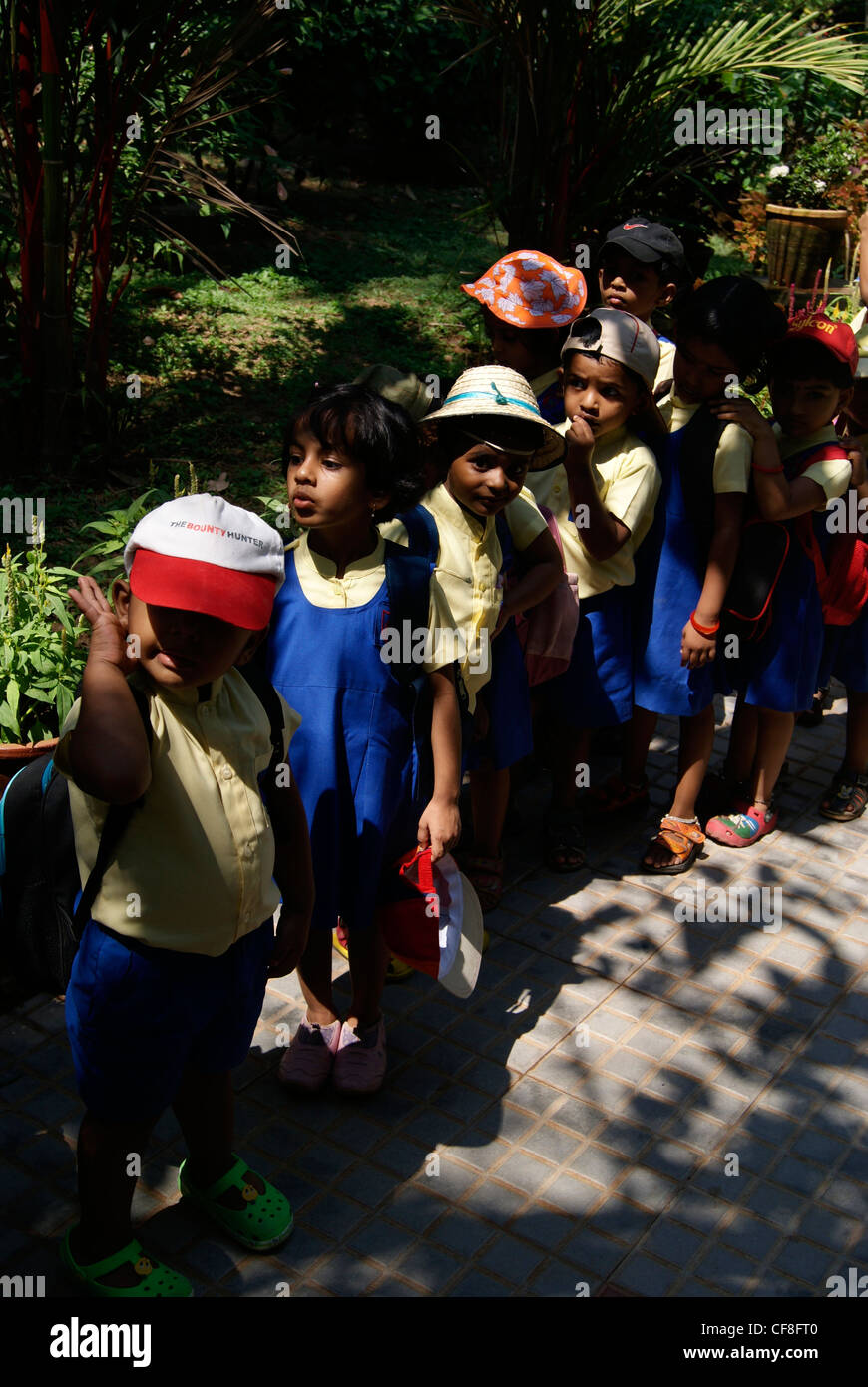 Lot of Nursery school students in Queue and enjoying garden scenery of Veli Tourist Village at Kerala,India - Stock Image