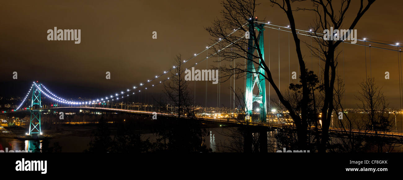 Lions Gate Bridge Over Burrard inlet in Vancouver Bc Canada at night Panorama - Stock Image