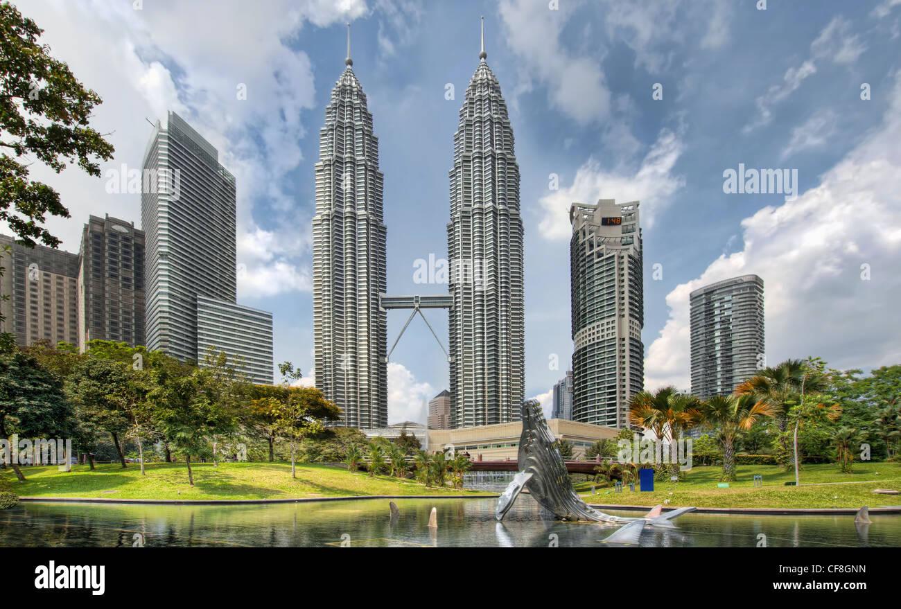 Kuala Lumpur Malaysia City Skyline from KLCC Park by the Lake - Stock Image