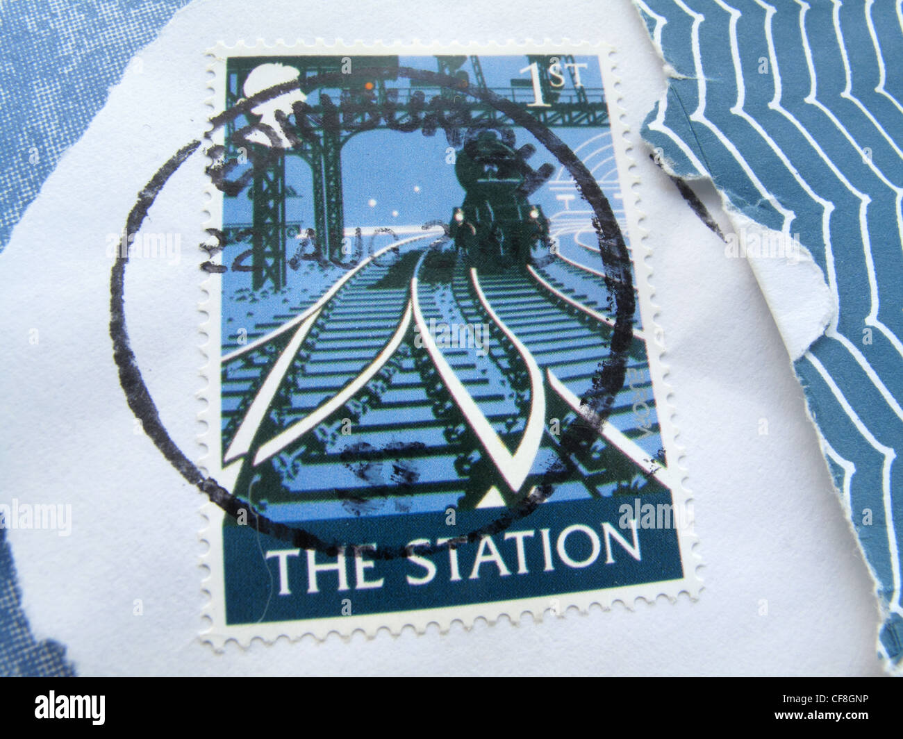 A close up of a  British first class  stamp franked in Ediburgh and showing the station railway lines and approaching - Stock Image