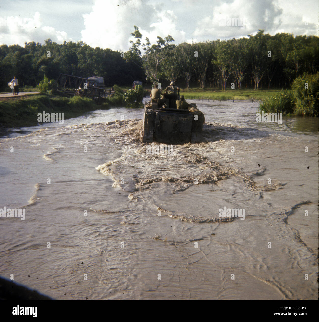 APC traversing river during search and destroy mission 1/5th (Mechanized) Infantry CU CHI VIETNAM War 1966 M113 - Stock Image