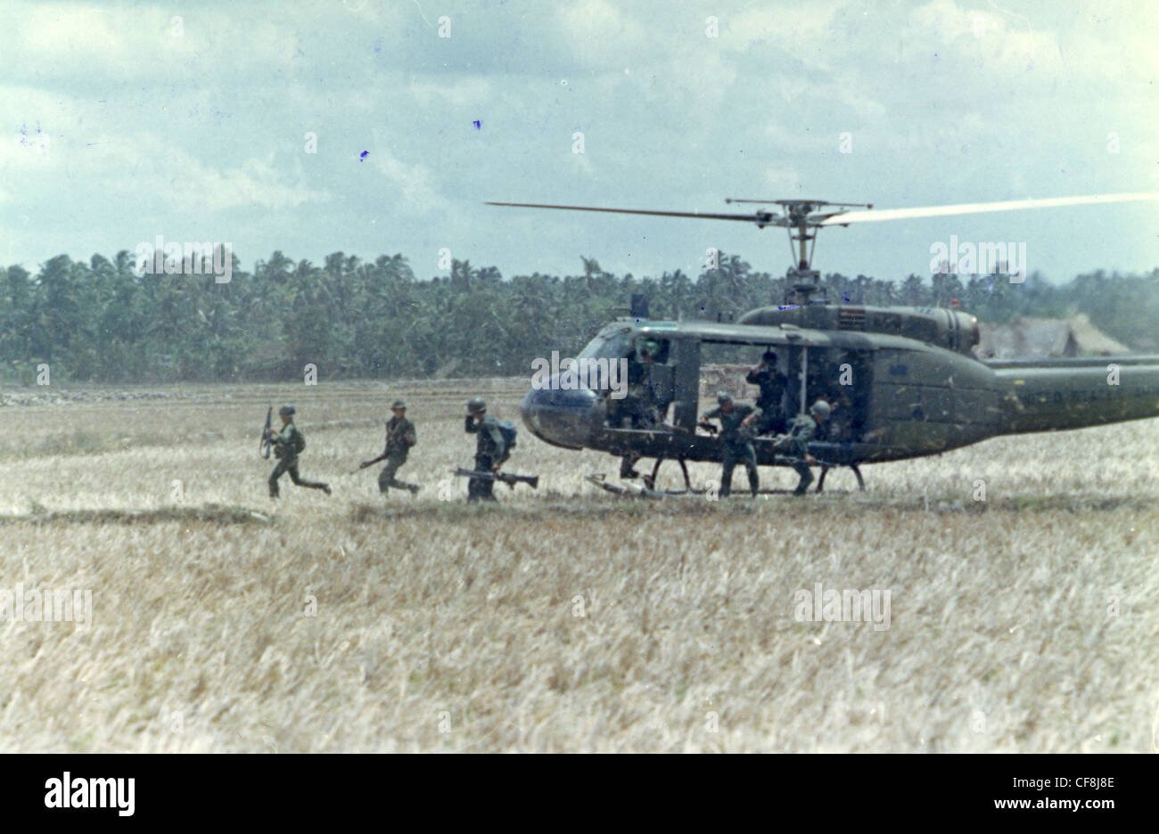 members of Co. D, 3rd BN, 506th Inf, 101st Airborne Division combat assault UH-1D helicopter 1970 huey helicopter - Stock Image