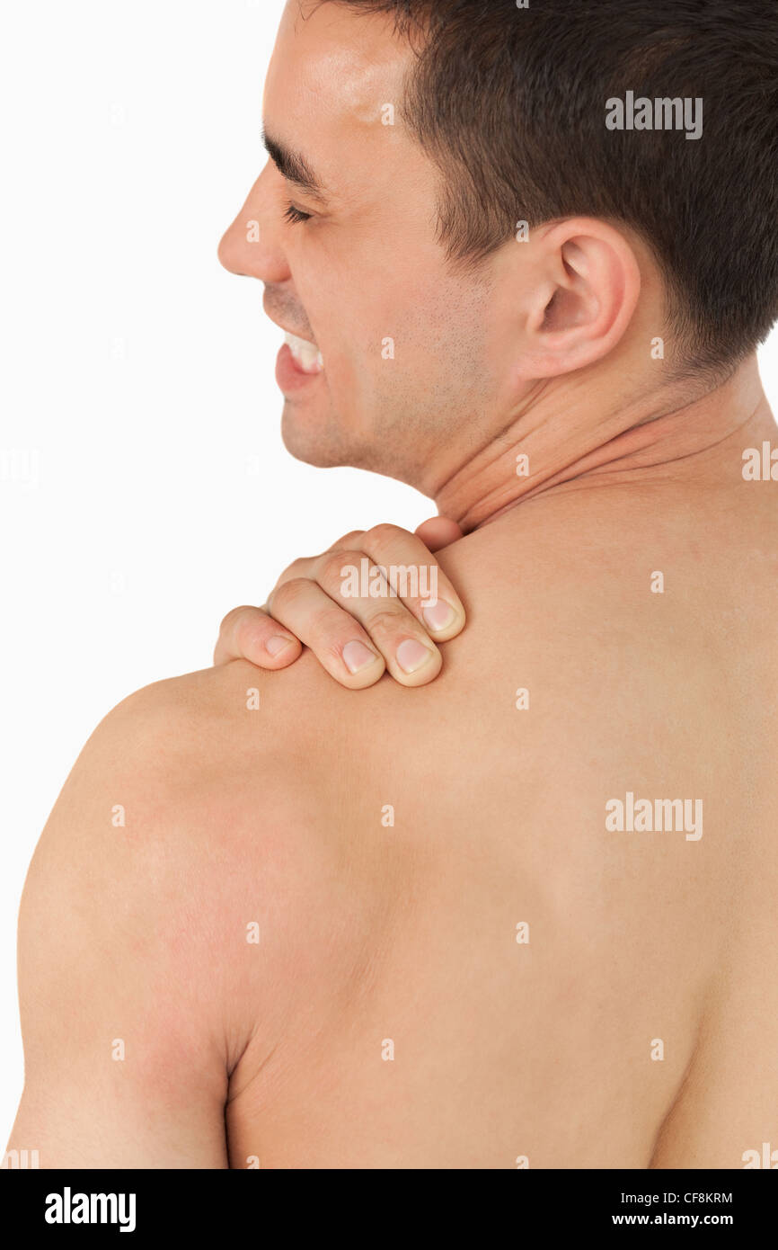 Young male experiencing neck pain - Stock Image