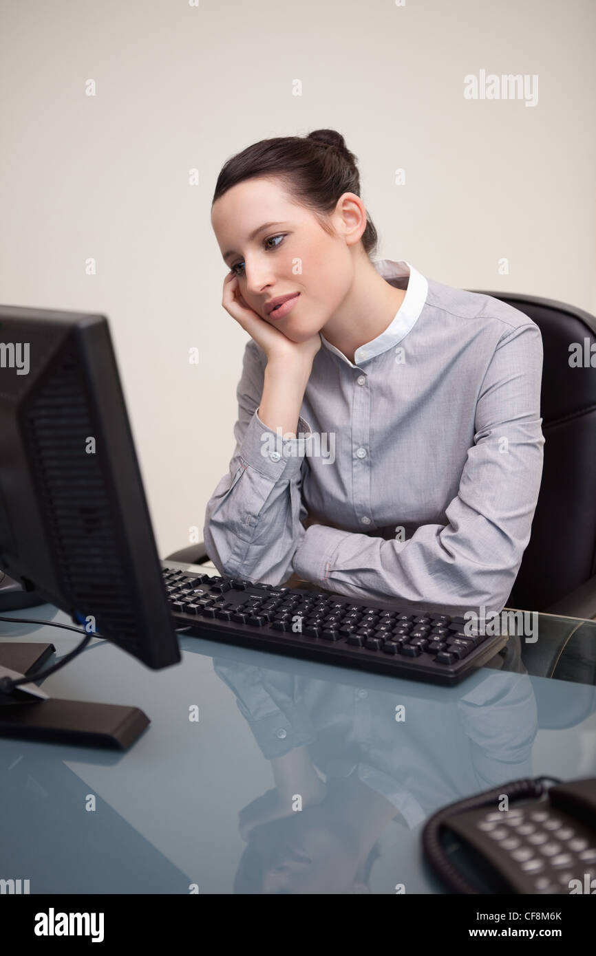 Businesswoman waiting patiently for her pc to work - Stock Image