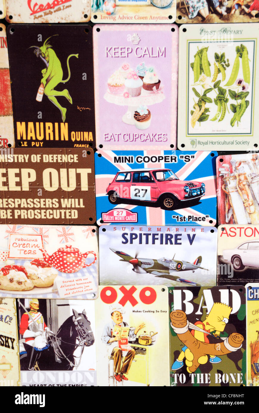 Vintage-style tin advertisement signs - Stock Image