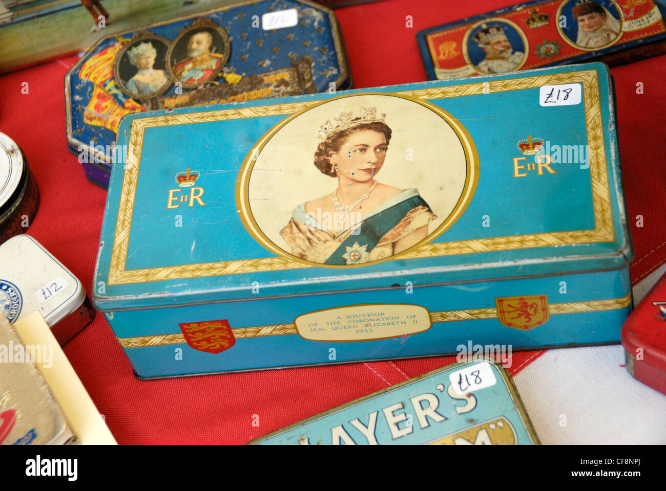 Tin boxes bearing images of British monarchs - Stock Image